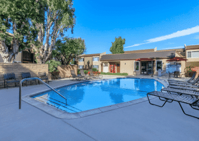Sparkling pool and spa with poolside recliners