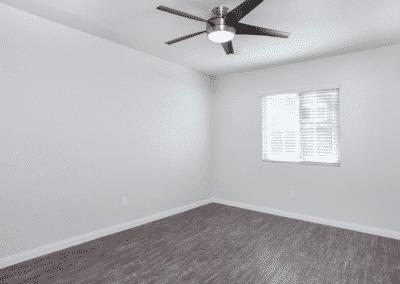 Wood style flooring, ceiling fan and window